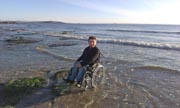 Young-man-in-wheelchair-at-the-ocean