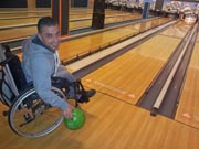 Young-man-in-wheelchair-ten-pin-bowling