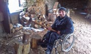 Young-man-in-wheelchair-chopping-wood