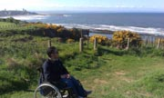Young-man-in-wheelchair-on-the-Scotish-coast
