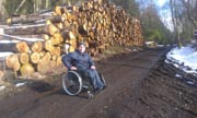 Young-man-in-wheelchair-on-country-logging-road