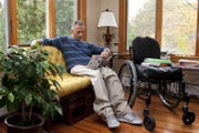 Man-in-wheelchair-at-home-on-cool-Autumn-afternoon