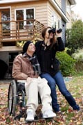 A-man-in-wheelchair-in-his-garden-in-Fall