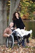 A-man-in-wheelchair-in-his-garden-in-Fall