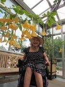 Woman-in-wheelchair-tending-her-plants-in-her-conservatory