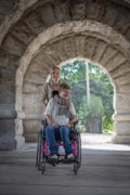 Mother-Wheeling-Her-Daughter-At-Park
