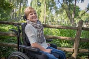 Happy-girl-with-disability-in-wheelchair-in-an-urban-park