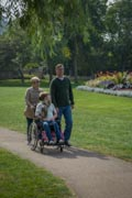 Parents-With-Their-Daughter-With-Disablility-Walking-At-Park