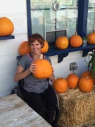 Woman-in-wheelchair-buying-pumpkins-for-Halloween