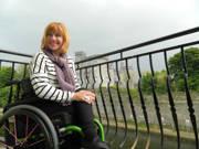 Woman-using-wheelchair-exploring-Kilkenny-Ireland