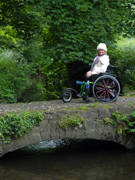 Woman-using-wheelchair-exploring-Kilkenny-Ireland