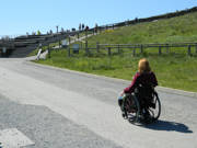 Woman-using-wheelchair-exploring-the-historic-Cliffs-of-Moher,-Ireland