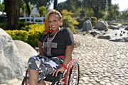 Woman-in-wheelchair-enjoying-lakeside-park