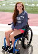 Young-woman-in-wheelchair-at-campus-sports-ground