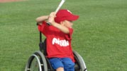 Young-boy-in-wheelchair-playing-baseball