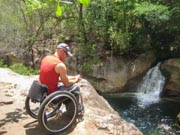 Man-in-wheelchair-overlooking-gorge-and-waterfall