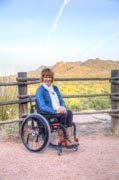 Woman-using-wheelchair-exploring-an-historic-outdoor-museum