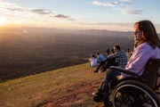 Yound-woman-in-wheelchair-on-hillside-watching-the-sunset