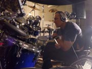 Man-in-wheelchair-in-music-studio-with-drum-kit