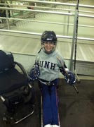 Young-woman-in-an-ice-hockey-sled-ready-for-the-rink