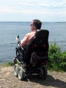 Man-in-power-chair-on-enjoying-coastal-scenery
