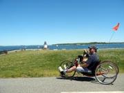 Man-handcycling-along-the-coast