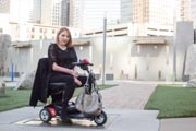 Woman-exploring-city-on-her-mobility-scooter