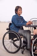 Two-women-in-wheelchairs-at-beachside-cafe