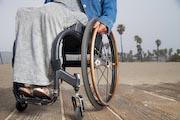 Woman-in-wheelchair-on-coastal-boardwalk