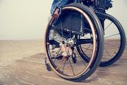 Woman-in-wheelchair-on-beachside-boardwalk