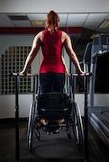 Young-woman-exercising-at-gym