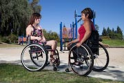 Two-woman-using-wheelchairs-in-playground