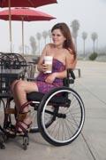 Woman-using-wheelchair-at-beachside-coffee-shop
