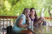 Two-friends-taking-selfies