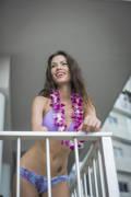 Young-woman-in-bikini-on-her-apartment-balcony