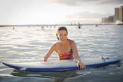 Young-woman-with-her-surfboard-on-Waikiki-Beach