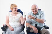 Disabled-couple-toasting-one-another-with-glass-of-Champagne,