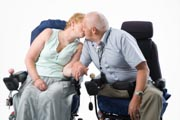 Disabled-couple-holding-hands-and-kissing,