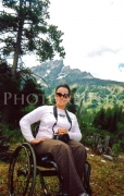 wheelchair;wilderness;outdoors;hiking;forest;lake;disability;disabled;woman;female;inclusive;sun