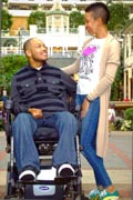 Man-using-power-wheelchair-out-with-his-girfriend-in-the-city
