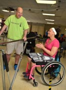 Man-using-parrallel-bars-in-rehabilitation-gym