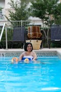 Woman-using-power-wheelchair-swimming-in-pool