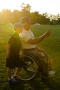 Father-in-wheelchair-playing-baseball-with-his-son