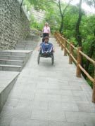 Man-in-wheelchair-descending-the-Great-Wall-of-China