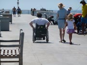 Man-using-wheelchair-on-jetty-in-California