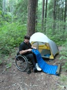 Man-in-wheelchair-camping