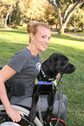 Woman-using-wheelchair-in-park-with-her-service-dog