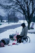 Man-in-wheelchair-attending-grave-stones-on-Memorial-Day