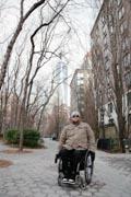 Man-in-wheelchair-exploring-seaside-village