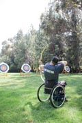 Man-in-wheelchair-practicing-archery